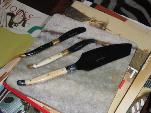 A selection of cheese knives and my marble serving board.