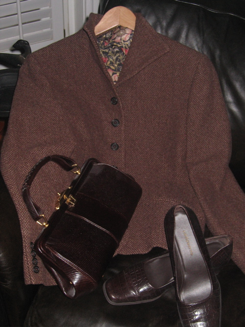 Part of a tweed suit by Ralph Lauren. Bag and shoes are faux croc.